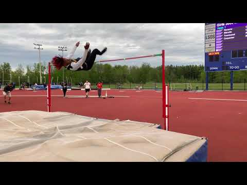 "Henninger High School high jumper Kwamere White clears 6' 9"""