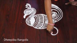 creative peacock rangoli design for beginners - latest peacock kolam - freehand rangoli designs