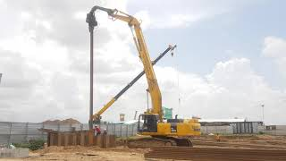 Amazing Excavator Komatsu PC400 deep sheet pile installation