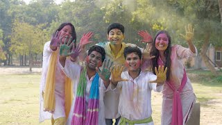 Indian friends excitedly showing their palms covered in powder colors - Holi festival