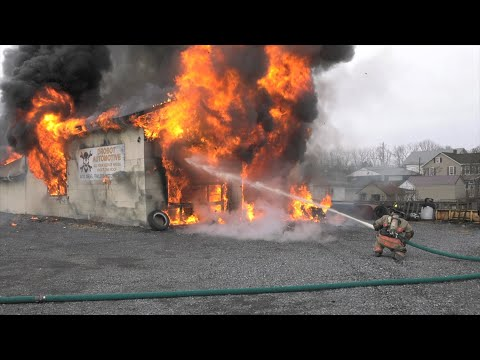 PRE-ARRIVAL:  Firefighters battle fire in auto repair shop, North Whitehall, PA.