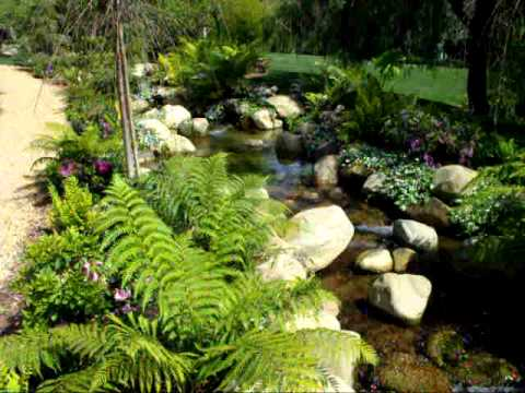 Super cool koi pond and waterfall with creek youtube for Cool koi ponds