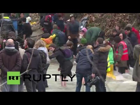 Thousands of refugees try to cross river near Greek-Macedonian border (recorderd live feed)