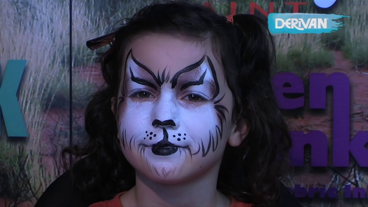 Body painting pussy face and