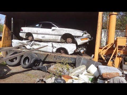 Car crusher crushing cars 48 ford mustang