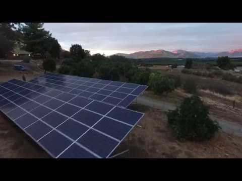 Installing solar array for farm house, beautiful aerial views by drone
