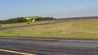 m squared ultralight lands on grass with floats