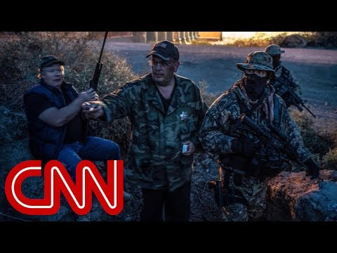 Armed militia group detains migrants at the border