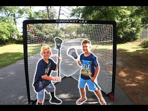 Lacrosse Kids Putting Together And Shooting On Portable Lacrosse Net