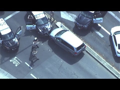 California officer leaps out of speeding van's path, opens fire on chase suspect
