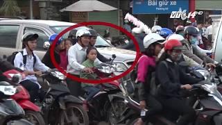 VTC14 |Phụ huynh vi phạm luật giao thông trước mặt con trẻ