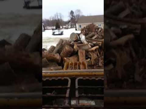 Caterpillar 246 moving boiler wood