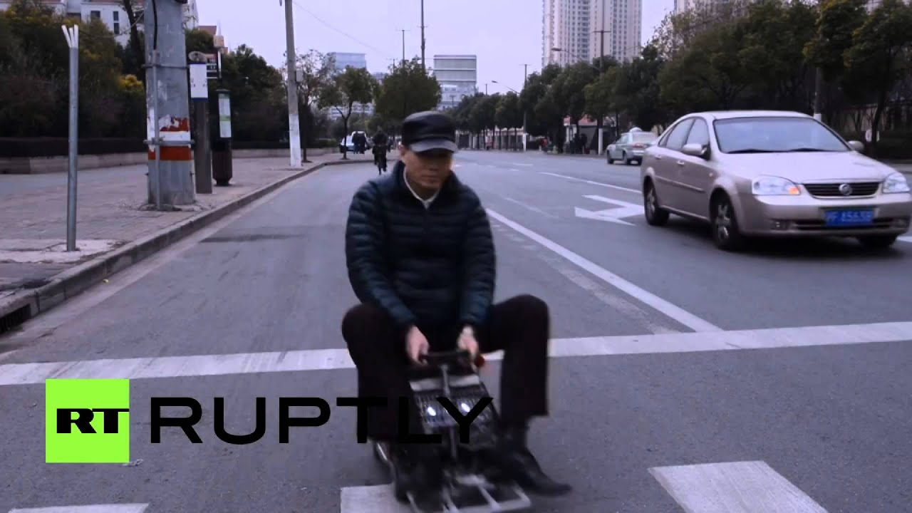 World\'s smallest car: Chinese inventor unveils home-made vehicle to ...
