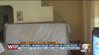 Furniture delivery warning: Woman stuck with bed in living room