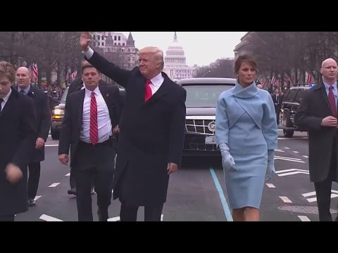 President Donald Trump gets out of limousine to walk in Inaugural Parade