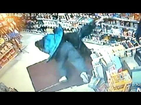 Clerk body slams armed suspect in robbery attempt