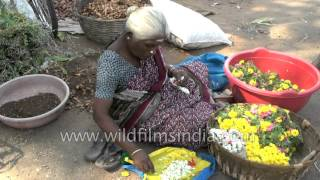 Old South Indian woman makes garland in Madurai