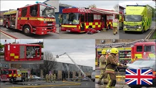 Large building fire in a warehouse - Many fire trucks on scene + firefighters in action
