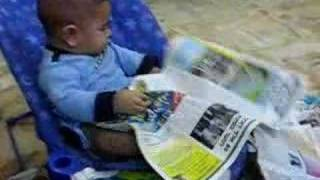 cute baby reading a magazine !!!
