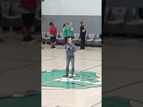 Kasey singing The National Anthem at Grantham Middle School staff/student game
