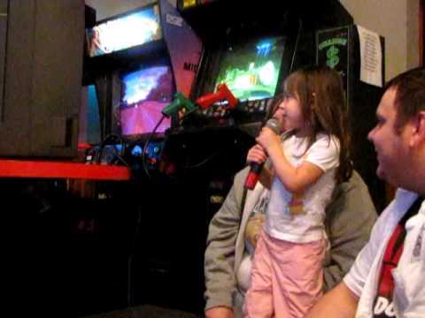 Allie singing 'Last Name' at Karoke Night