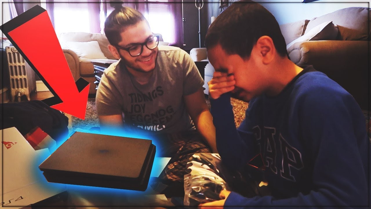 9 YEAR OLD BROTHER GETS SURPRISED WITH A PS4 FOR CHRISTMAS! HIS ...