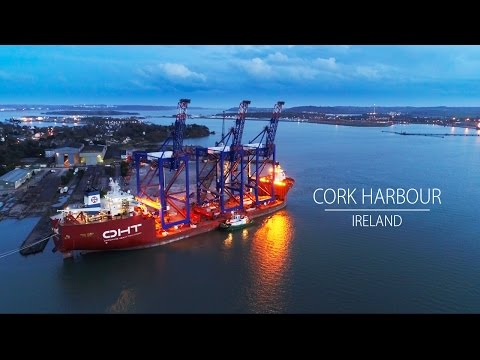 Drone footage of 3 giant Liebherr cranes loaded on to massive ship in Cork Harbour