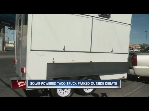 Solar-powered taco truck parked outside UNLV debate