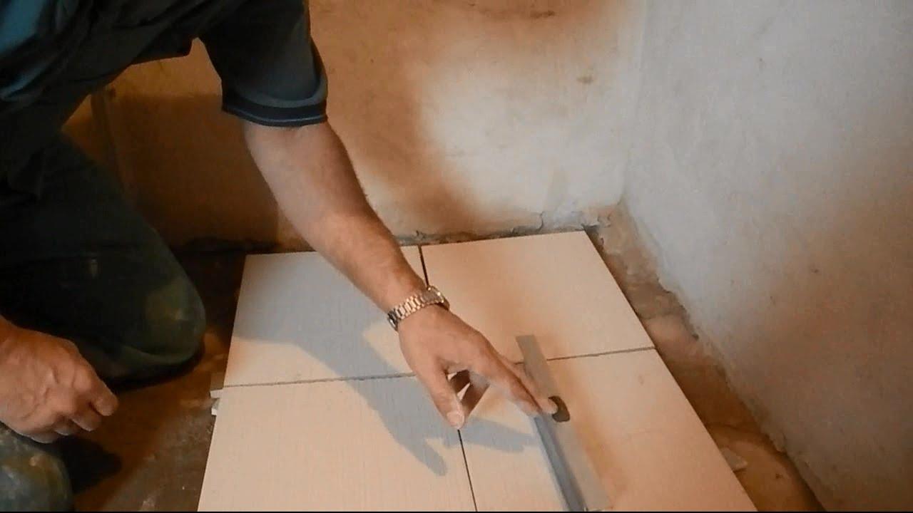 Укладка плитки с уклоном под слив