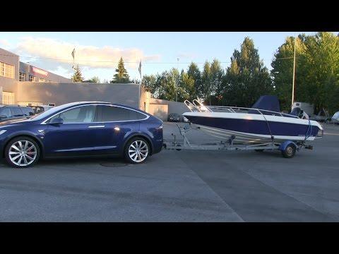 Tesla Model X towing a boat