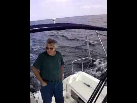 contour34 trimaran sailing out of gloucester mass harbor