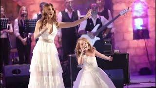 Nancy Ajram sings with a child نانسي عجرم تغني مع طفلة بأغنية بدنا نولع الجو