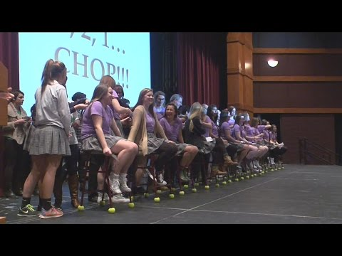 More than 150 girls from Divine Savior Holy Angels High School donate their hair to charity