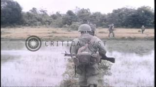 United States soldiers of 1st Infantry Division advance forward towards a battlef...HD Stock Footage