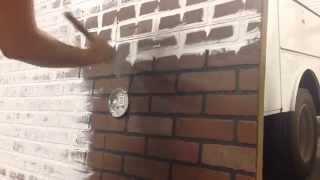 Whitewashing faux brick.