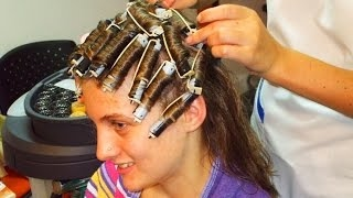 Teenager getting a rollers perm and a short haircut