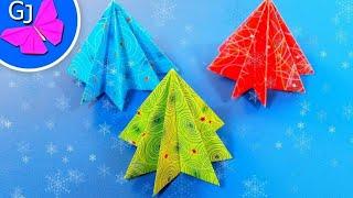 Как сделать елку из бумаги ~ Новогодние оригами(Быстрый способ украсить комнату или класс - сделать простую оригами ёлку из бумаги! Это легкая оригами елоч..., 2014-11-30T14:27:19.000Z)