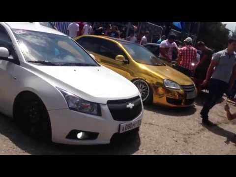 Gold VW Jetta And Chevrolet Cruze