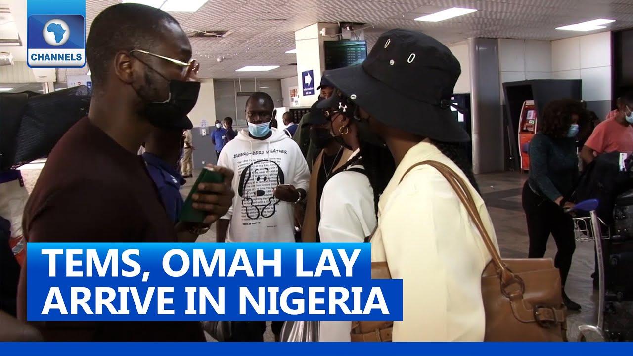 Download Tems, Omah Lay Arrive In Nigeria