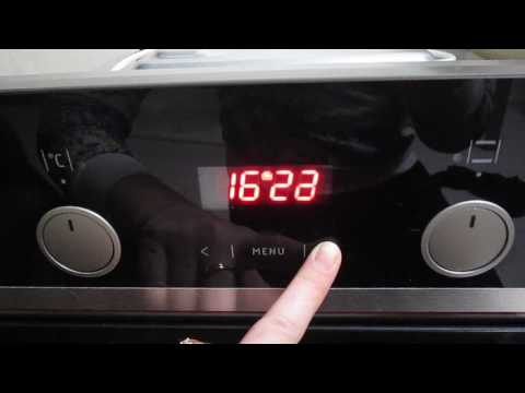 Как установить часы на духовом шкафу