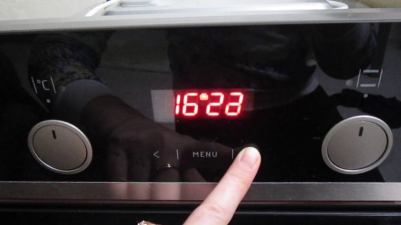 Инструкция: как настроить часы на духовом шкафу.