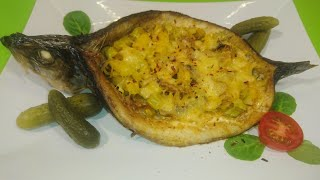 Селедка запеченая с овощами
