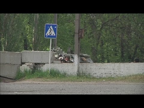 Gunshots heard at a checkpoint in Ukraine's eastern town of Slaviansk