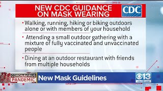 People outside who are vaccinated will no longer be advised to wear a mask stop the spread of covid-19.