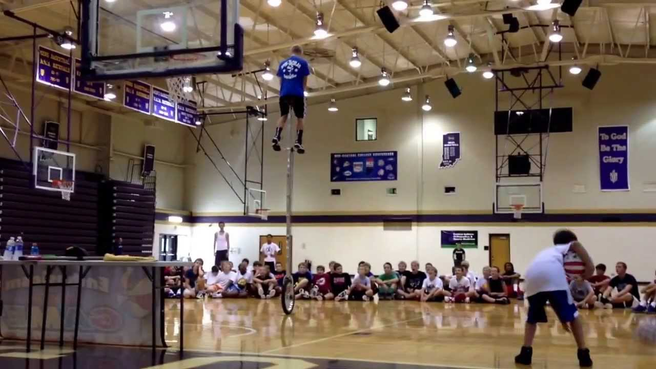 Caleb Crevier Ball Handling and Juggling on Unicycle - YouTube