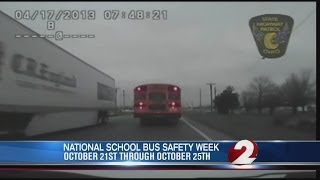 Semi passes stopped school bus in Logan County