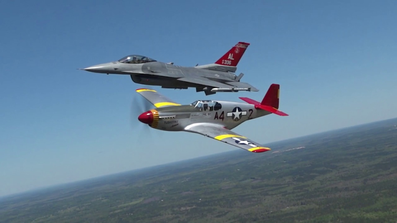 CAF Red Tail Squadron's P-51C Mustang flies in formation with F-16 in honor of Tuskegee Airmen
