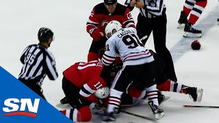 Drake Caggiula and Ben Lovejoy Drop The Gloves As Blackhawks And Devils Brawl To End Game
