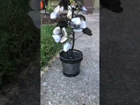Metal flowers in a metal pot