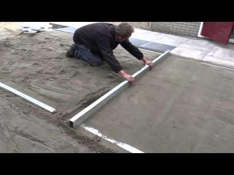 Tuinaanleg: Afrijen voor aanleg terras met keramische tegels